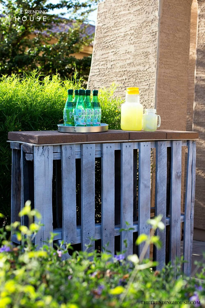 A Recycled Pallet Bar Near a Hedge