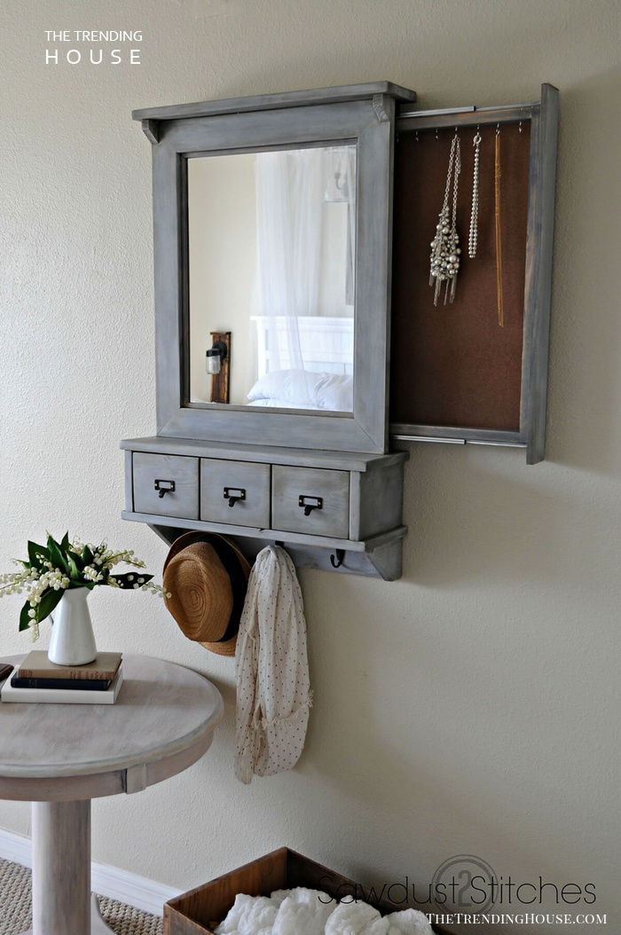 A Wall Mirror with Three Storage Areas