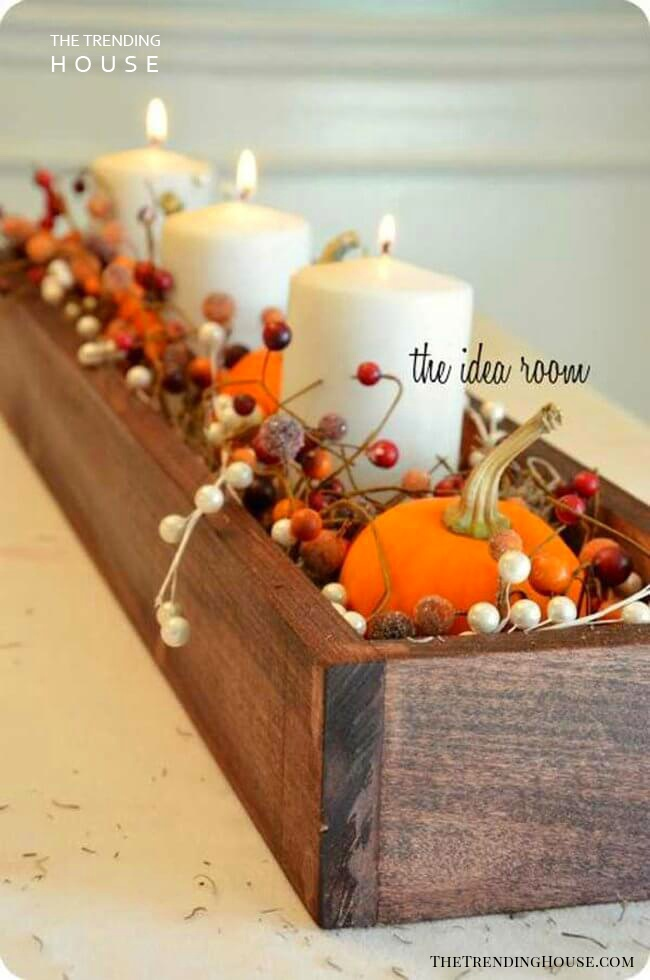 Fall-Inspired Centerpiece with Bright Orange Pumpkins