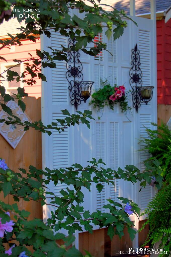 Graceful Garden Wall with Sconces