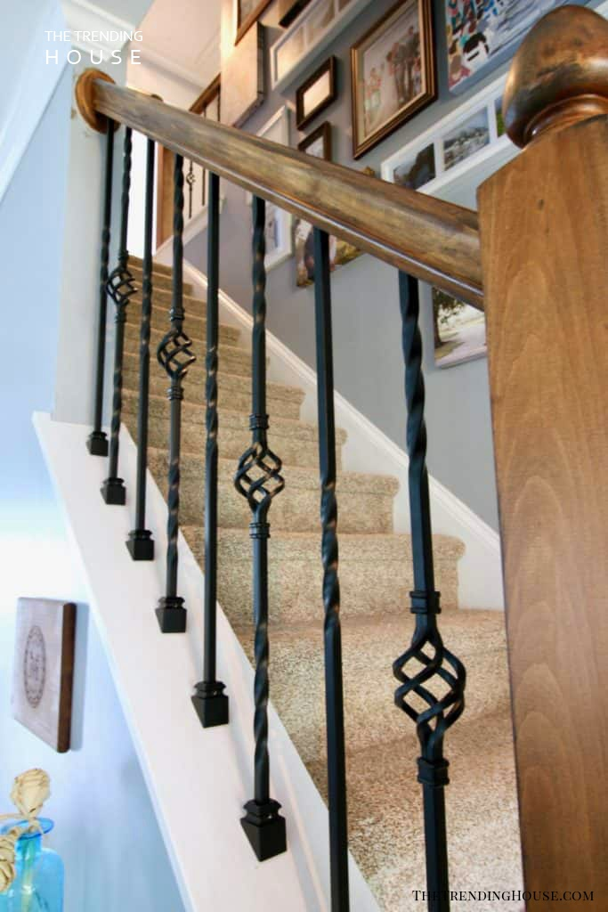 Intricate Metal Rails Against Wooden Bannister