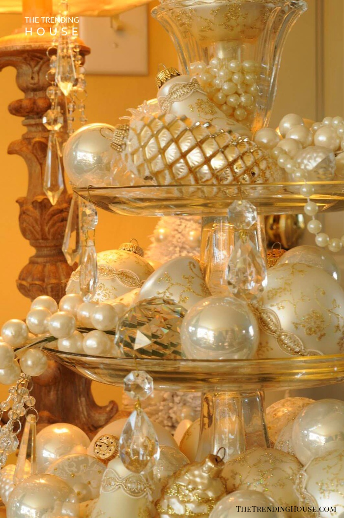 Lavish Crystal Display Featuring Pearl, Gold, And Ivory Ornaments