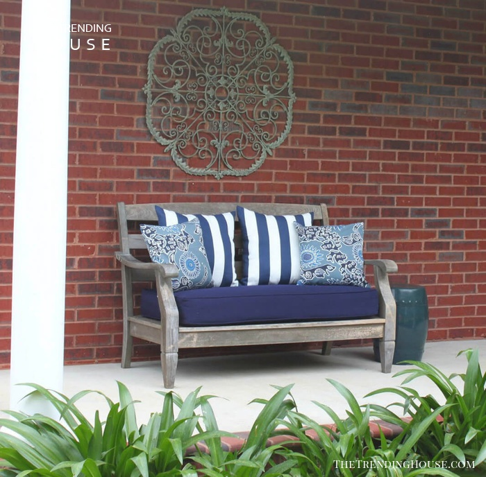 Metal Scrollwork Wall Hanging Over a Bench