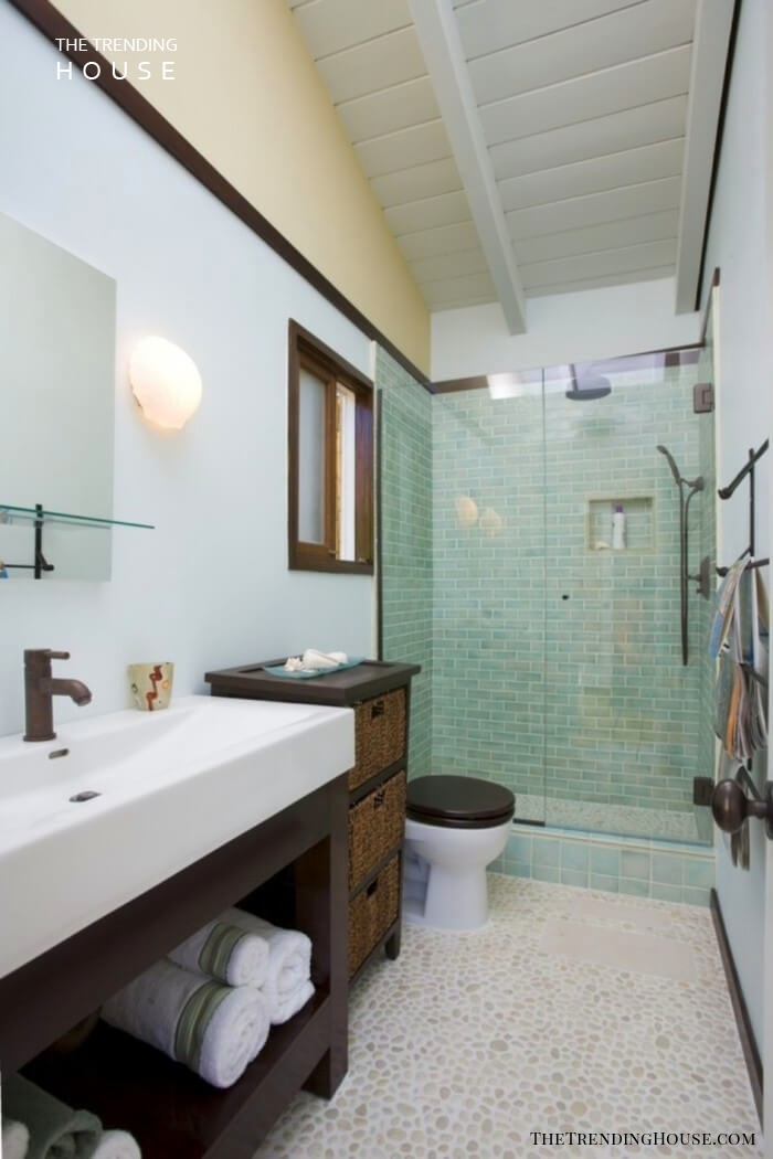 Pebble Tile Floor Paired with Aqua Shower Walls
